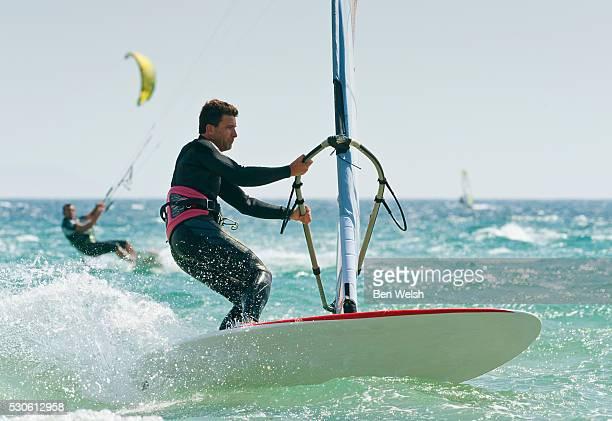 Windsurfers In The Water Off Punta Paloma; Tarifa Cadiz Andalusia Spain