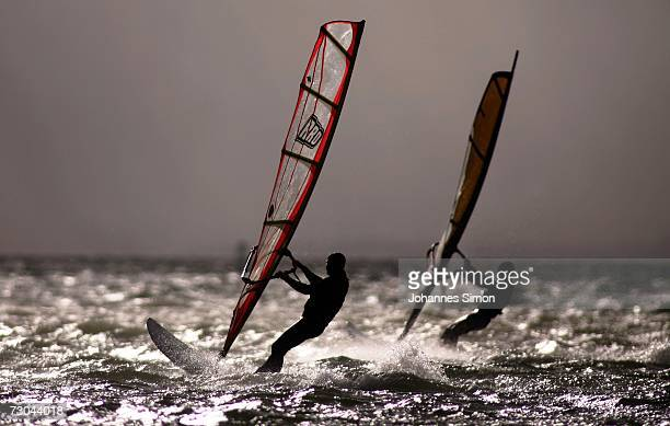Windsurfers make the most of the high winds and swell on Lake Ammersee January 19 near Stegen Germany The storm sytem 'Kyrill' pounded Germany...