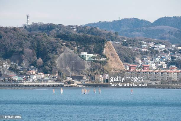 Windsurfers practicing on the silent beach in Kamakura in Japan
