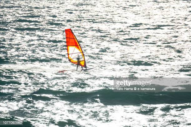 Windsurfers sailing on Sagami Bay, part of Pacific Ocean in Japan