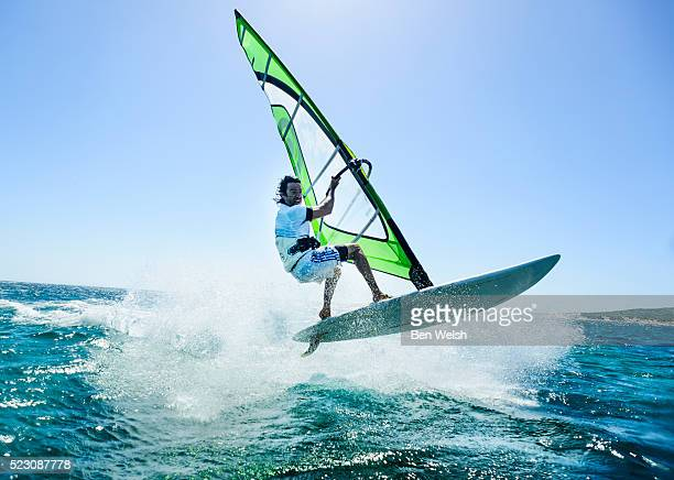 windsurfing action. - windsurfing stock pictures, royalty-free photos & images