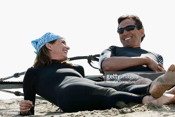 Windsurfing couple on beach