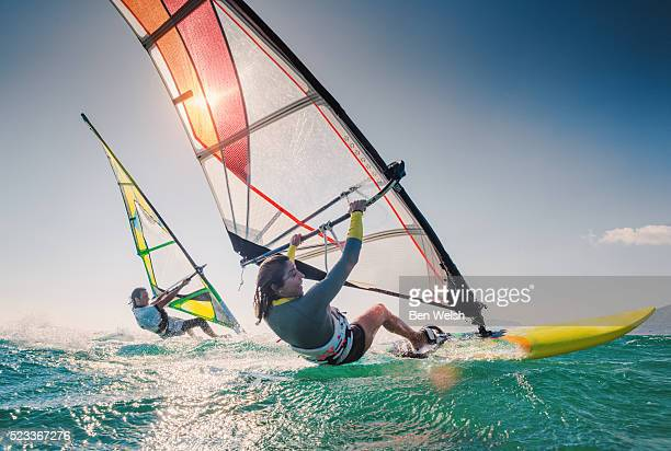 windsurfing couple - windsurfing stock pictures, royalty-free photos & images