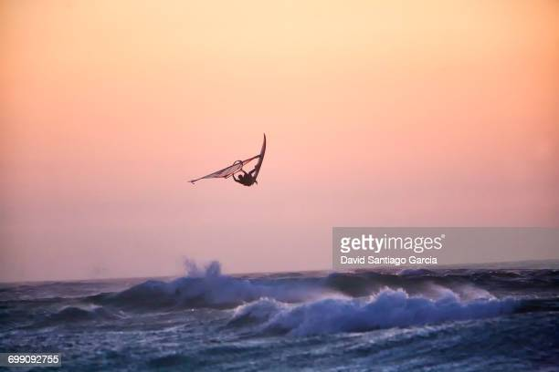 windsurfing off guincho beach near cascais, portugal - windsurfing stock pictures, royalty-free photos & images
