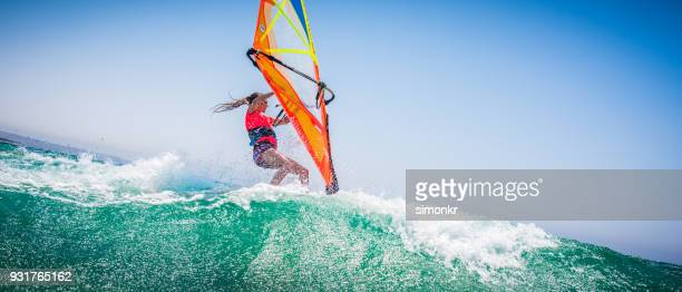 windsurfing on sea - windsurfing stock pictures, royalty-free photos & images