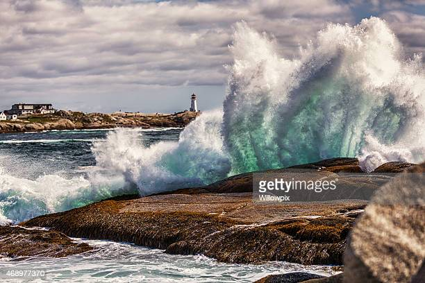 windswept heavy surf at peggys cove nova scotia canada - breaking wave stock pictures, royalty-free photos & images