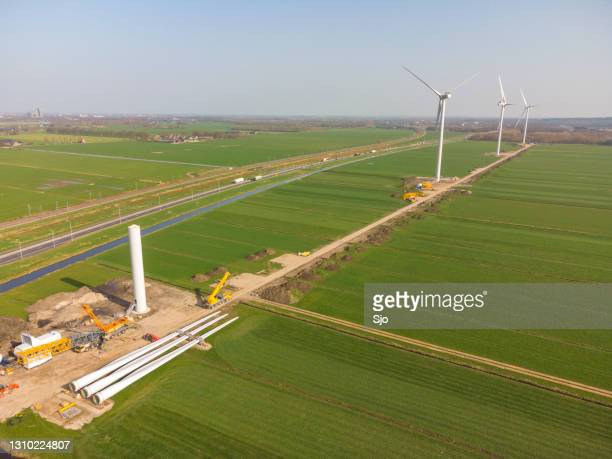"""windturbines in a new wind park at a construction site - """"sjoerd van der wal"""" or """"sjo"""" stock pictures, royalty-free photos & images"""