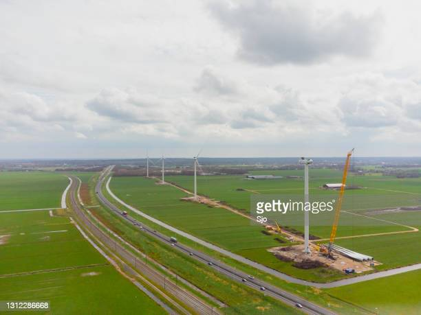 "windturbines in a new wind park at a construction site - ""sjoerd van der wal"" or ""sjo"" stock pictures, royalty-free photos & images"