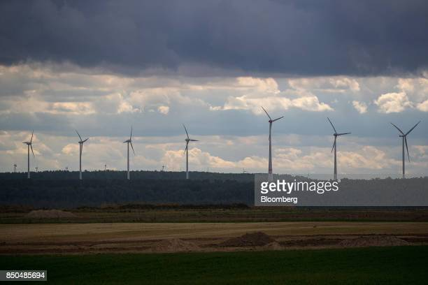 Windturbines stand near the village of Poedelwitz Germany on Wednesday Sept 6 2017 By 2030 the eastern German town of Poedelwitz will likely be razed...