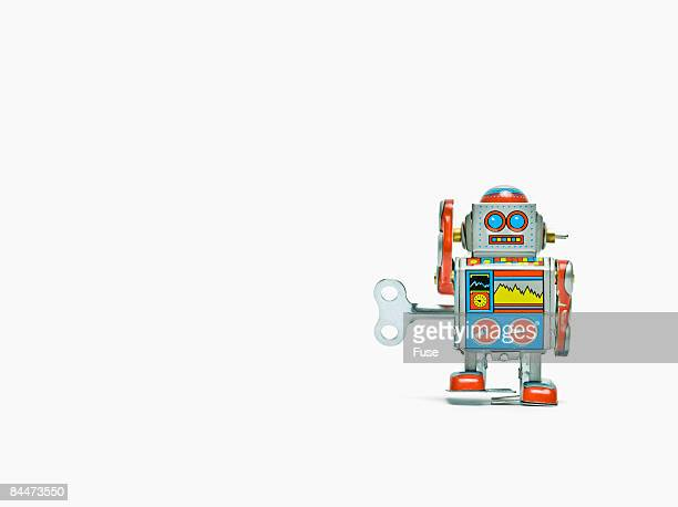 windup robot toy - wind up toy stock photos and pictures