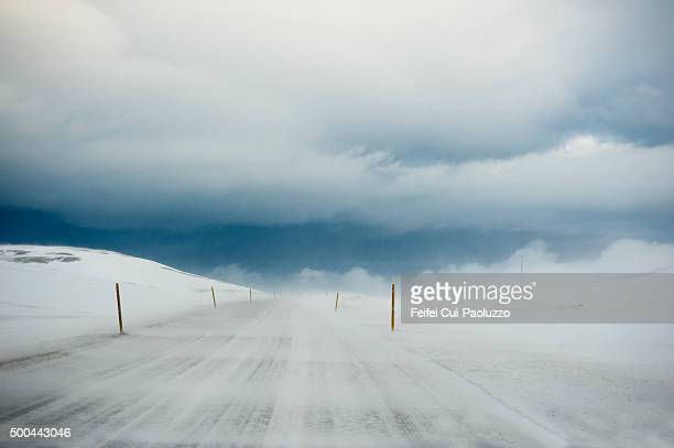 windy and snowy road at blonduos in the north of iceland - blizzard stock pictures, royalty-free photos & images