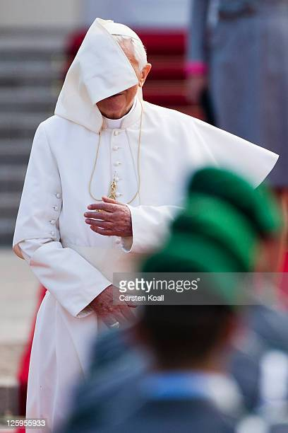 A windy breeze covers the face of Pope Benedict XVI as he visits German President Christian Wulff and First Lady Bettina Wulff at Schloss Bellevue...