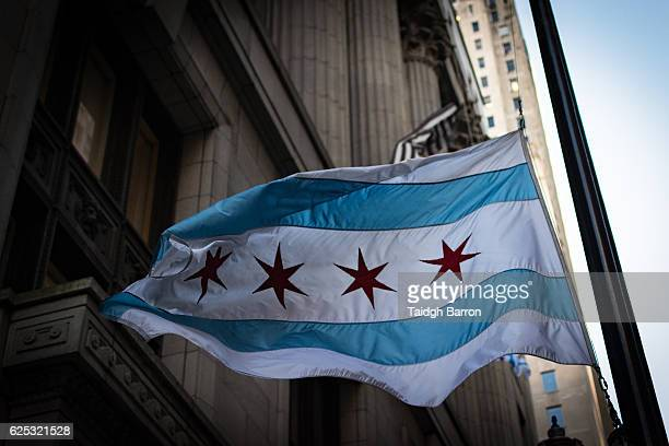 windy chicago flag outside city hall - cook county illinois stock photos and pictures