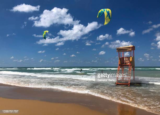 a windy day at the beach - water sport stock pictures, royalty-free photos & images
