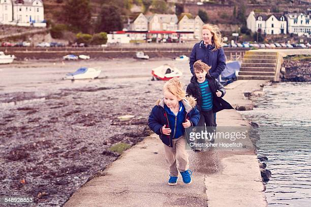 windy estuary walk - one parent stock pictures, royalty-free photos & images