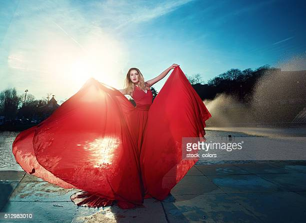 windy moment of fashion - wind blowing up skirts stock photos and pictures