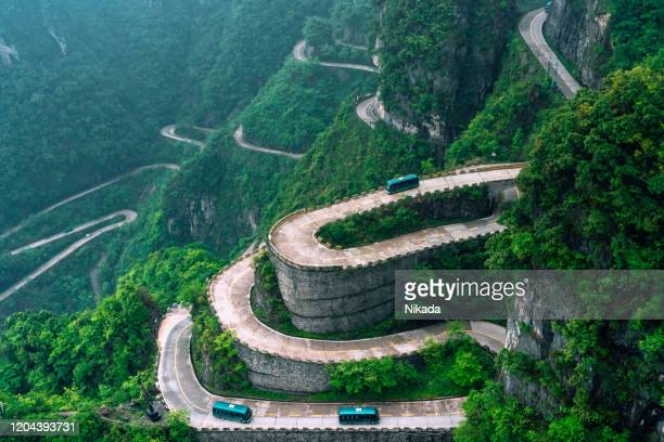 windy mountain road in china - steep stock pictures, royalty-free photos & images