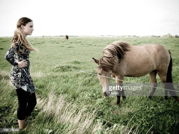 windy... - girl blowing horse stock pictures, royalty-free photos & images