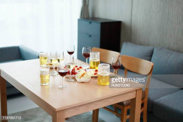wine and beer glasses with desserts on table - 公的祝日 ストックフォトと画像