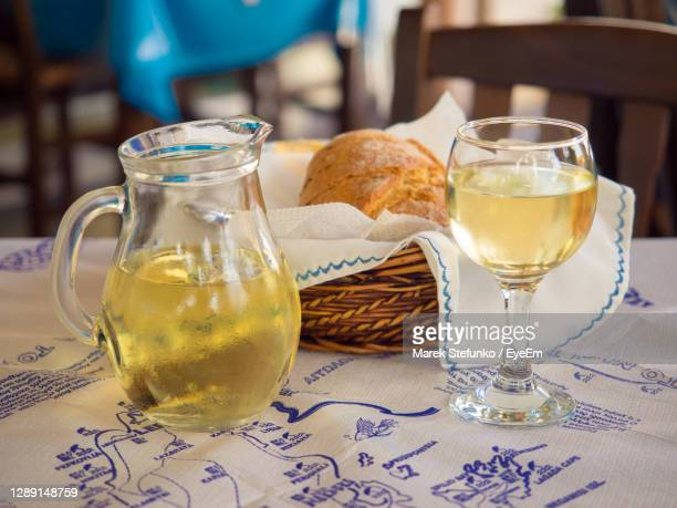 wine and bread in greek restaurant on lefkada island - marek stefunko stock pictures, royalty-free photos & images