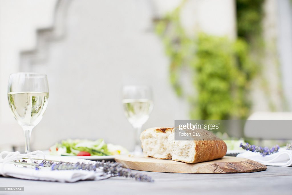 Wine and bread on patio table : Stock Photo