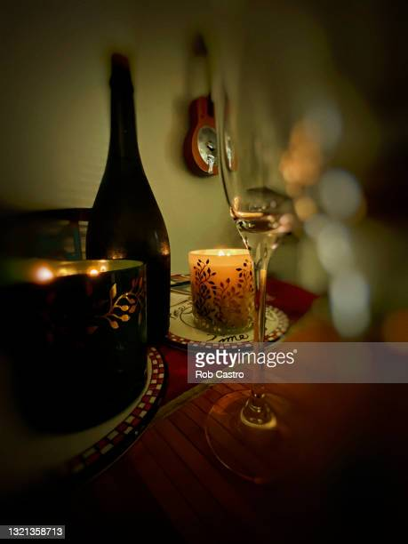 wine and candles - rob castro stock pictures, royalty-free photos & images