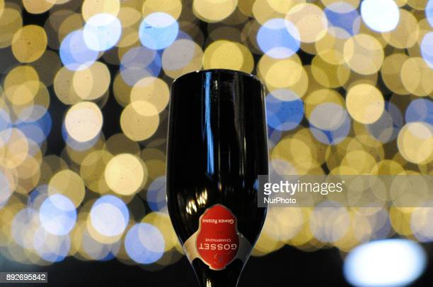 Wine and champagne bottles are seen decorating a mock Christmas tree in front of a restaurant in Bydgoszcz Poland on December 14 2017