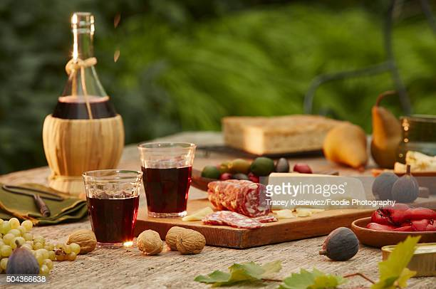 wine and cheese picnic - tuscany stock pictures, royalty-free photos & images