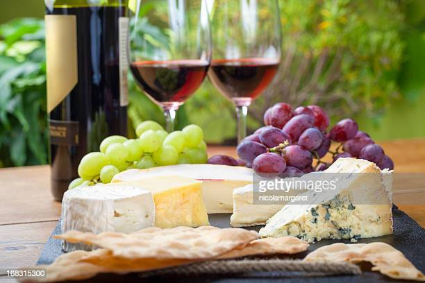 wine and cheese platter - french culture stock photos and pictures