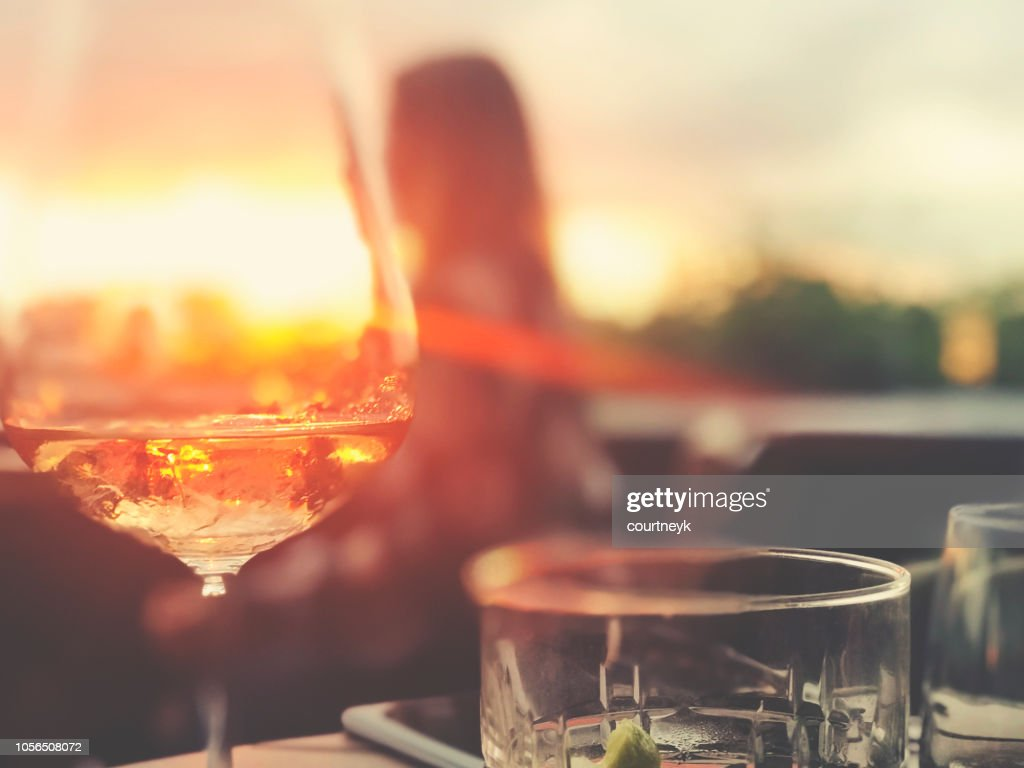 Wine and cocktails on a table at a bar. : Stock Photo