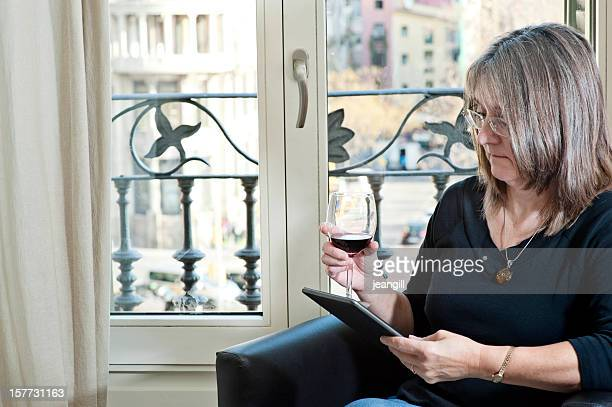 Wine and electronic tablet on holiday