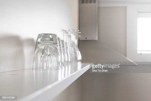 Wine and juice glasses on shelf