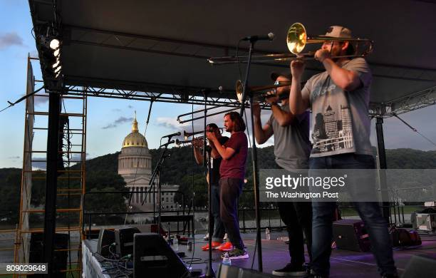 Wine and music fans enjoyed the sounds of The High Mighty Brass Band at the Wine All That Jazz Festival on the banks of the Kanawha River at the...
