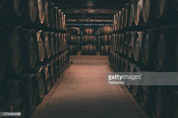 wine barrels in cognac, france - charente stock pictures, royalty-free photos & images