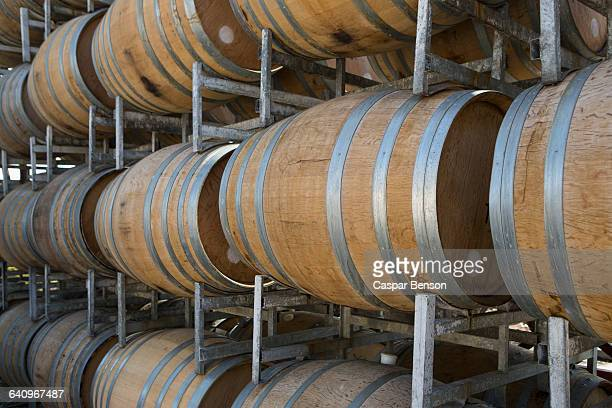 wine barrels in shelves at cellar - barossa valley stock pictures, royalty-free photos & images