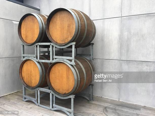 wine barrels in warehouse storage - rafael ben ari foto e immagini stock