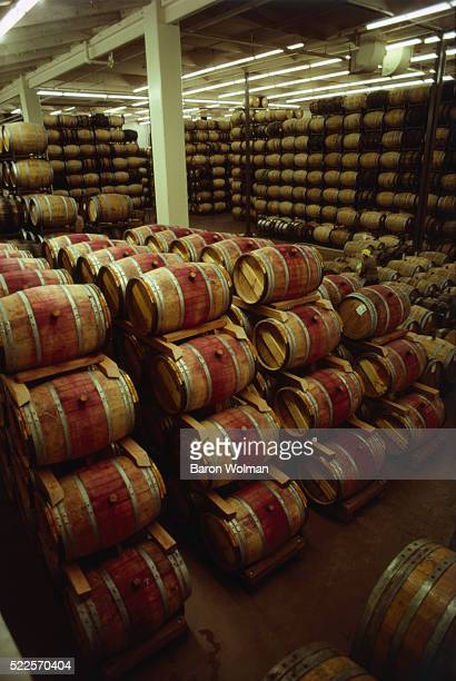 Wine barrels pile at Mondavi Winery, St Helena, CA, United States, circa 1970s.