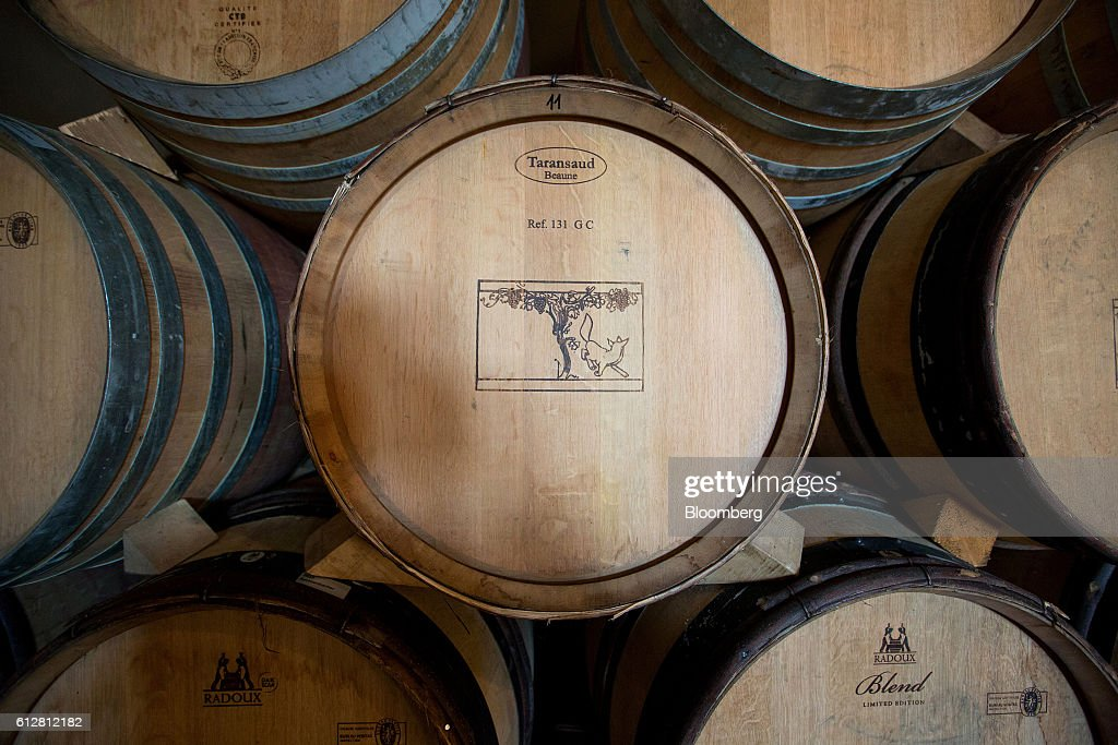 Wine barrels sit stacked in a temperature-controlled building inside the Weingut Friedrich Becker Estate in Schweigen, Germany, on Tuesday, Oct. 4, 2016. Global warming has been good to German viticulture, with average temperatures up 1.4 degrees centigrade over the past 40 years, creating the perfect climate for notoriously finicky pinot noir vines. Photographer: Krisztian Bocsi/Bloomberg via Getty Images