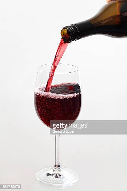 Wine being poured from bottle