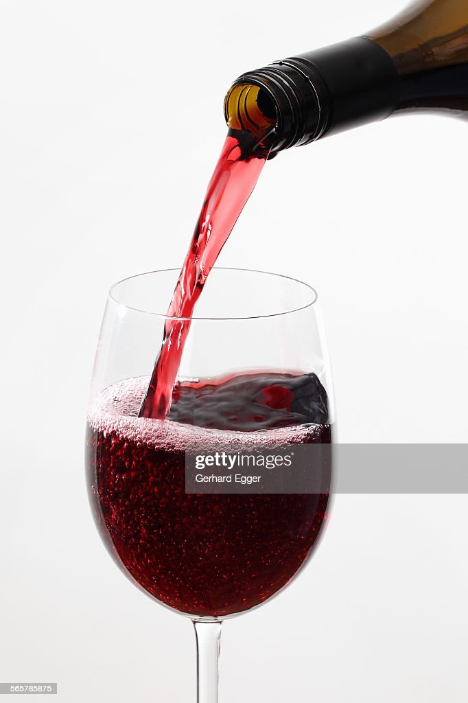Wine being poured from bottle : Stock Photo