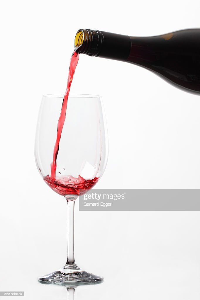 Wine being poured from bottle : Foto de stock