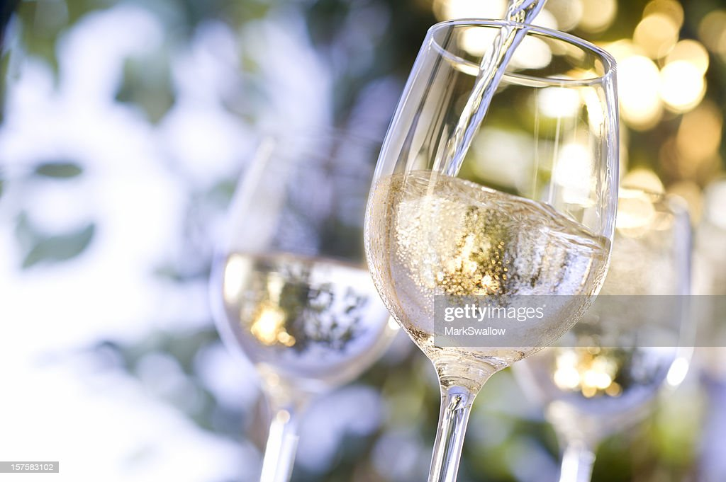 Wine being poured into glass : Stock Photo