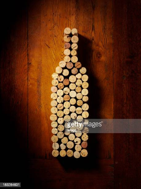 wine bottle and corks - cork stopper stock photos and pictures
