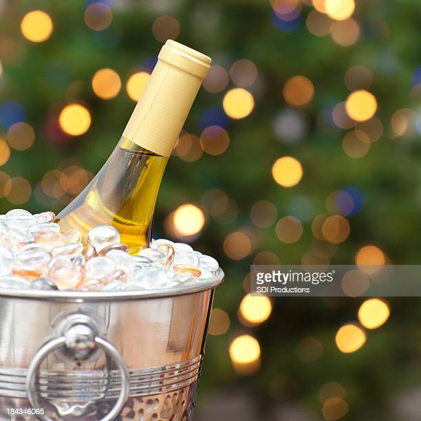 Wine Bottle In Front of a Christmas Tree