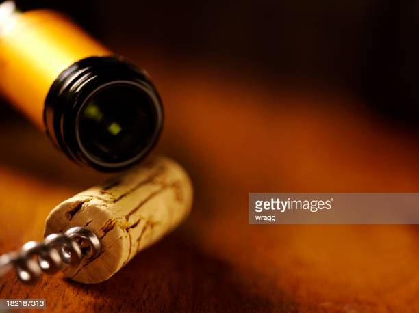 wine bottle,cork and opener on a table - cork stopper stock photos and pictures