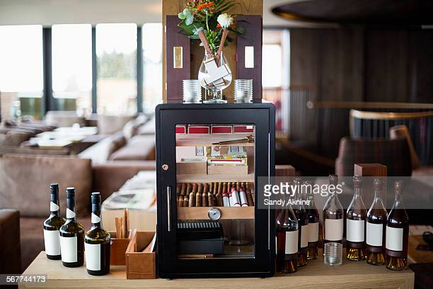 wine bottles and cigars in bar area of a salon, crans-montana, swiss alps, switzerland - valais canton stock pictures, royalty-free photos & images