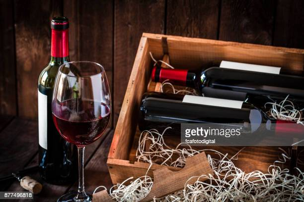Wine bottles and wineglass shot rustic wooden table