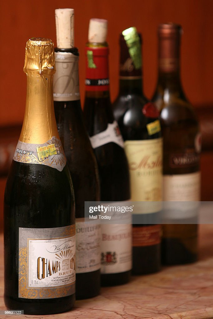 Wine Bottles are displayed at a wine tasting session in New Delhi on April 19, 2010.