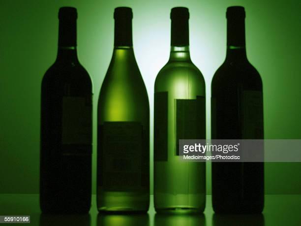 wine bottles in a row - softfocus stockfoto's en -beelden