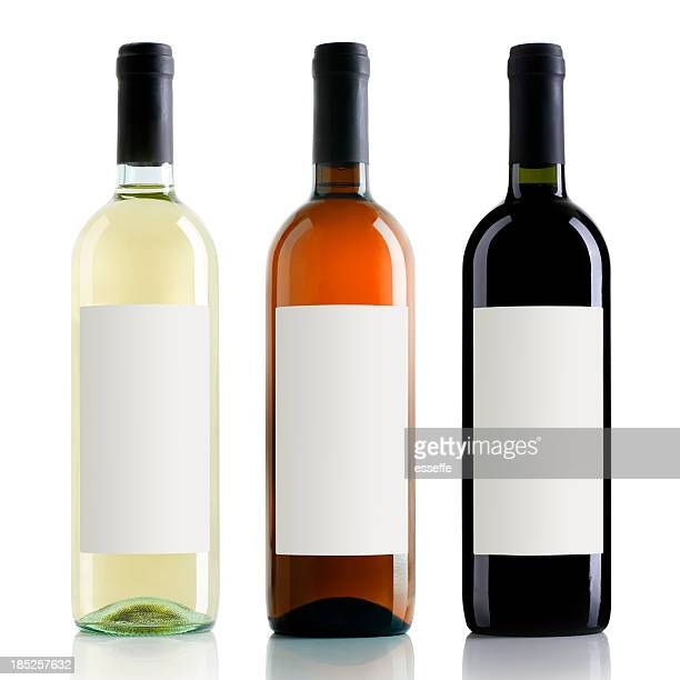 wine bottles - white wine stock pictures, royalty-free photos & images